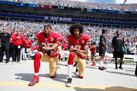 Colin Kaepernick kneeling during the national anthem. Photo credits to ESPN.