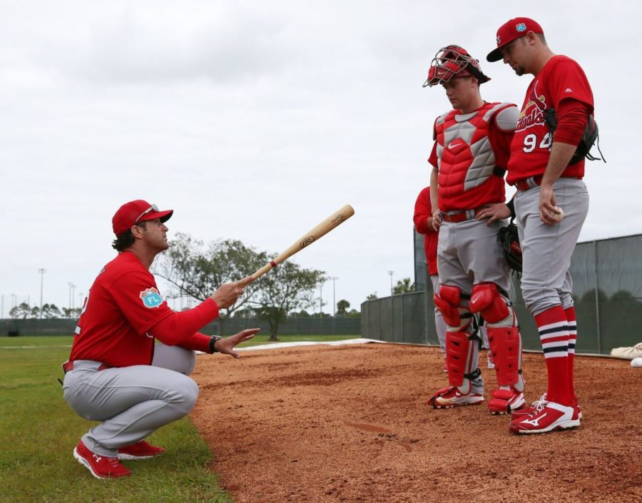 Mike Matheny works with young catcher Carson Kelly and pitcher Austin Gomber.