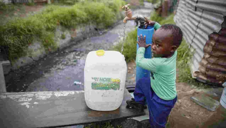 This+picture+shows+a+South+African+boy+collecting+his+water+for+the+entire+week.+