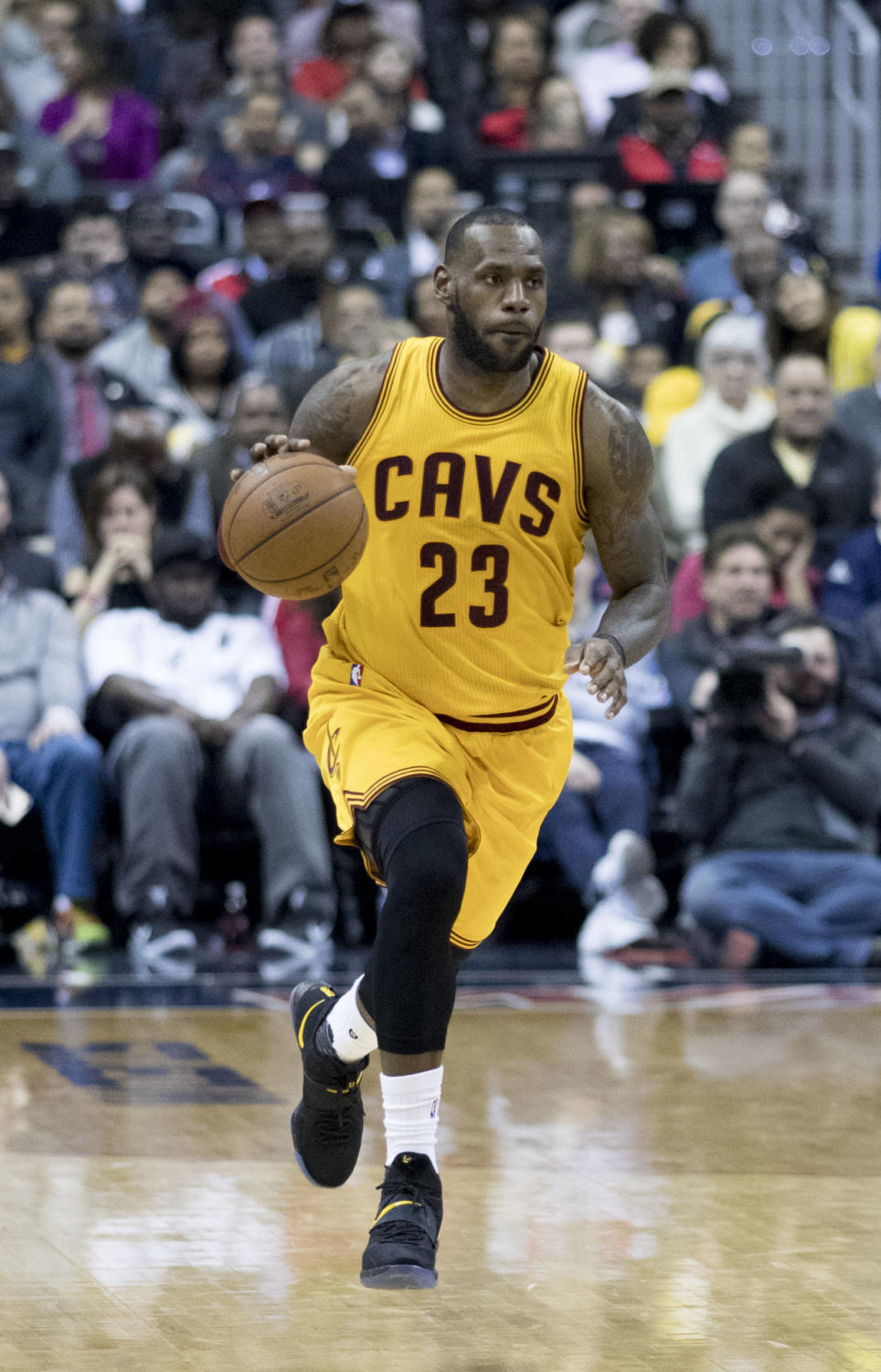 Lebron James takes the ball up the court in a crucial playoff game