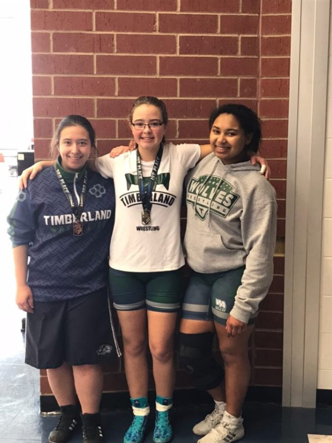 The three members of the innaugural THS Women's Wrestling team, Ashton Estill, Kayla McGennis and Cha'mya Adams.