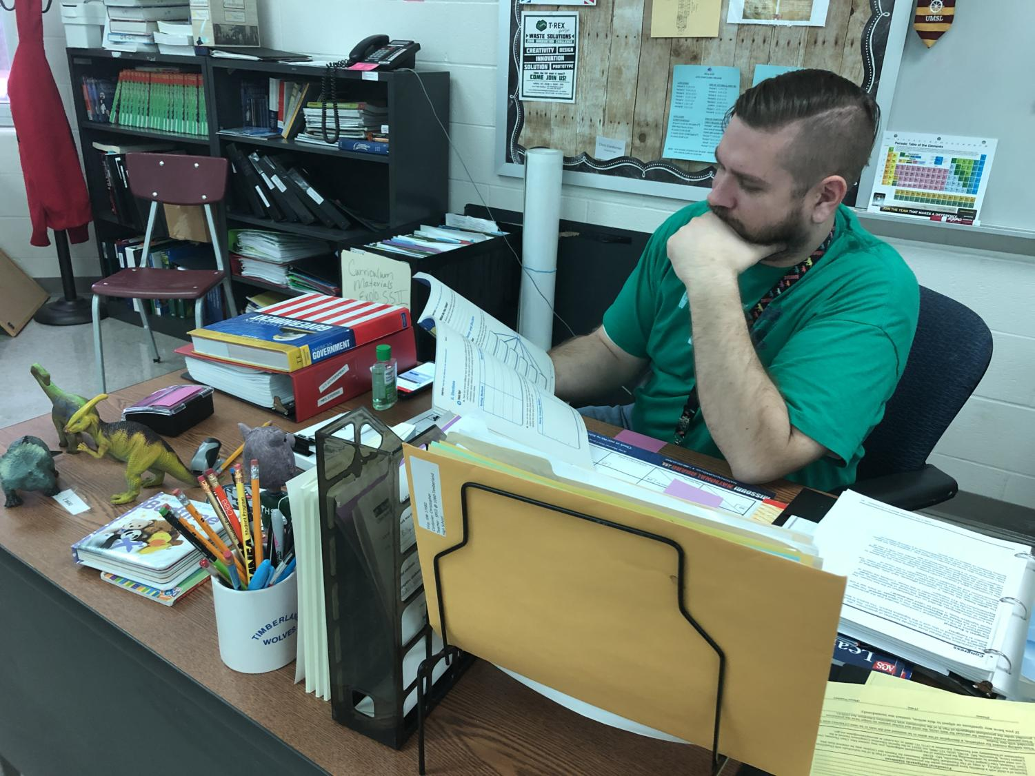 Teacher Chris Codonier at his desk in his classroom on the second floor of THS.