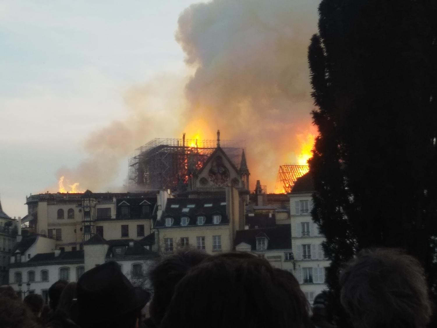The roof of Notre Dame's roof burning.