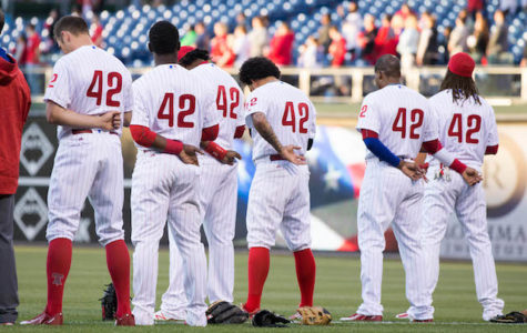 Apr 15, 2016; Philadelphia, PA, USA; The Philadelphia Phillies wearing number 42 on Jackie Robinson day stand for the national anthem before the start of the game against the Washington Nationals at Citizens Bank Park. Mandatory Credit: Bill Streicher-USA TODAY Sports