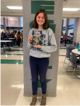 "Freshman Peighton Weber holds her first published book, ""Smoke and Ashes;"" it was published March 17.  ""The reason I wrote a book was not because of an inspiration or role model, but because I wanted to create a story of my own,"" Weber said."