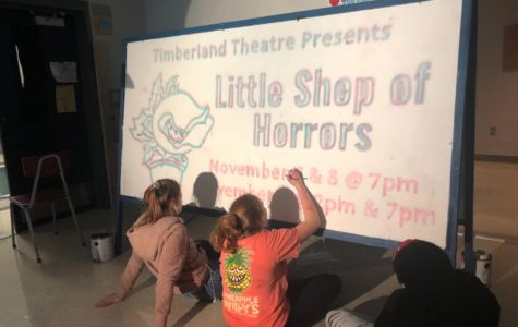 Cast Members creating a sign for