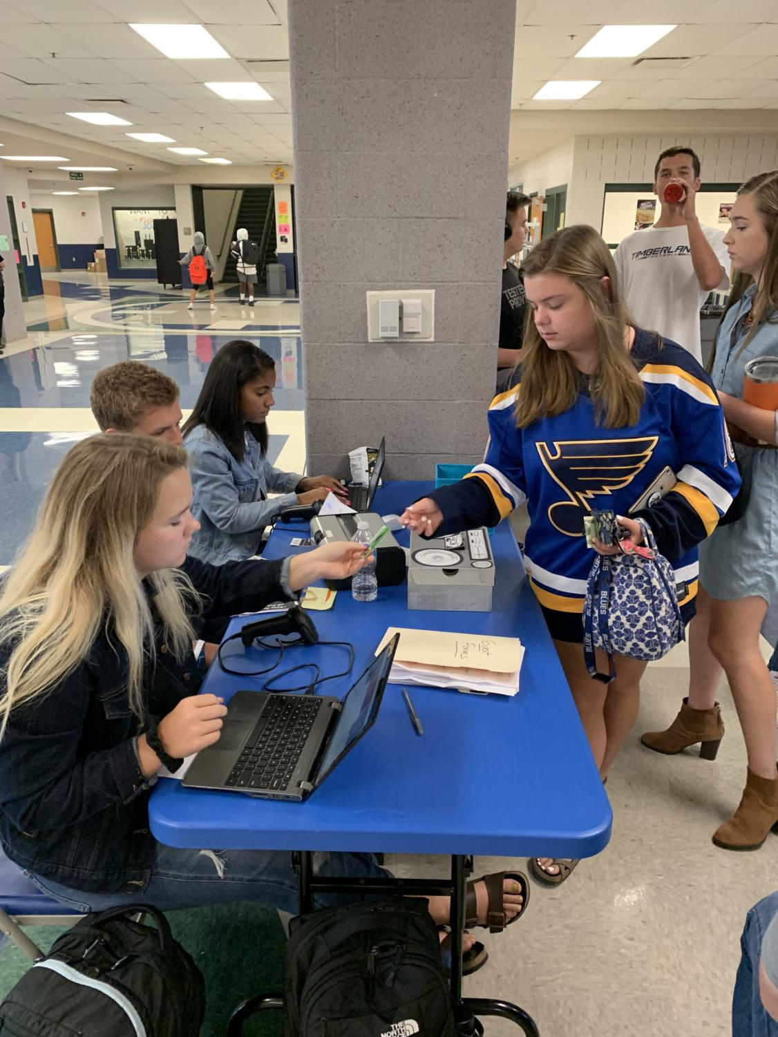 Students purchase homecoming tickets during lunches.