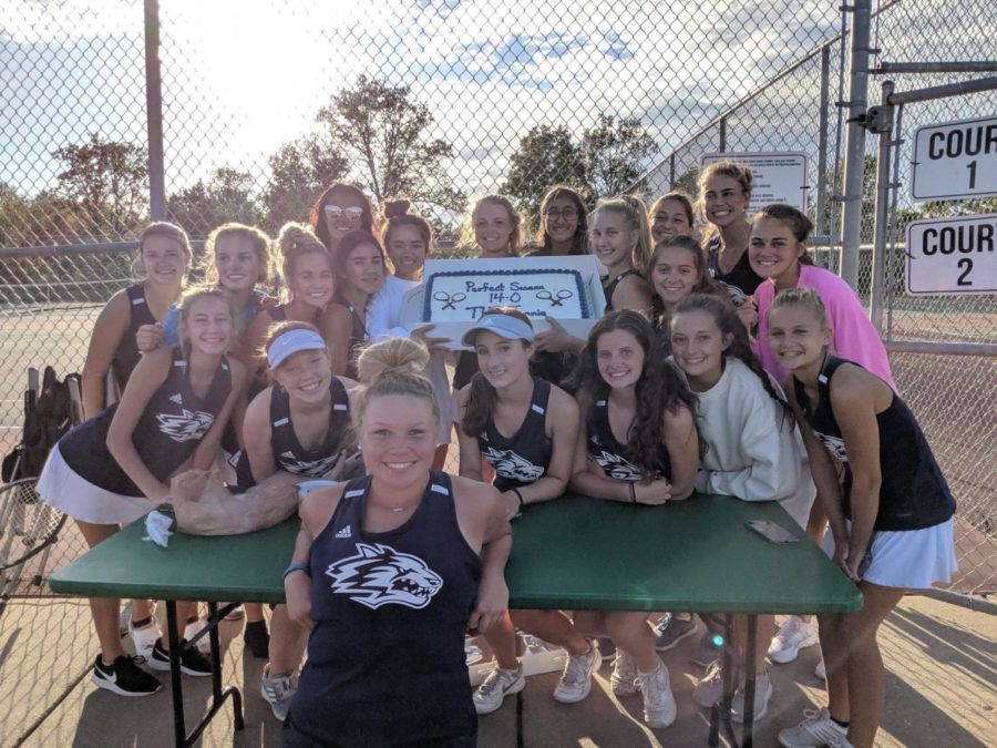 Girls+tennis+team+celebrating+their+undefeated+season.