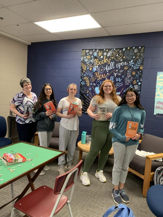 A few book club members, as well as sponser Kimberly Mora, show what books they are currently reading.